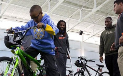 Broncos get in the holiday spirit with Boys & Girls Club bike giveaway